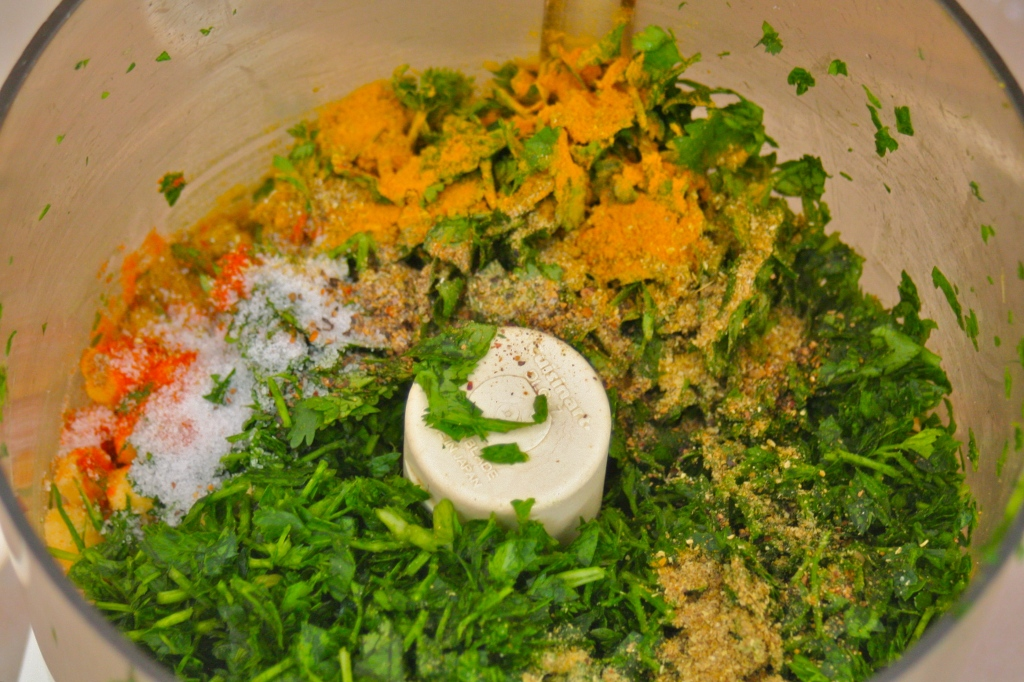 Green baked falafel preparation. Chickpeas, spices and herbs in a food processor