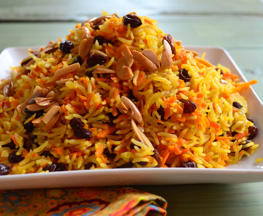 A mountain of Rosh Hashanah Sweet Basmati Rice with Carrots & Raisins  on a square plate
