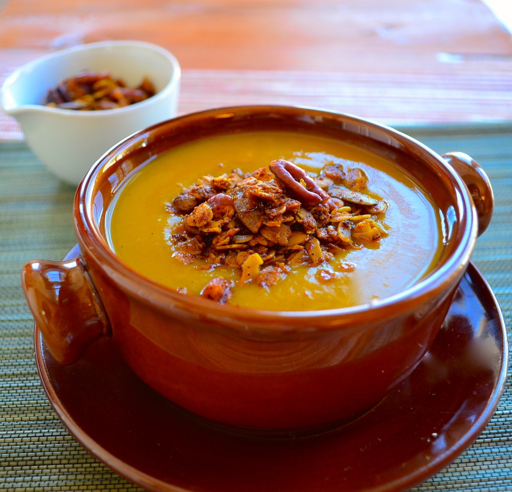 Creamy Vegan Pumpkin Soup with Spiced Savory Granola. Warm, comforting with a crunchy savory granola topping, a real crowd pleaser for Thanksgiving and all winter long.