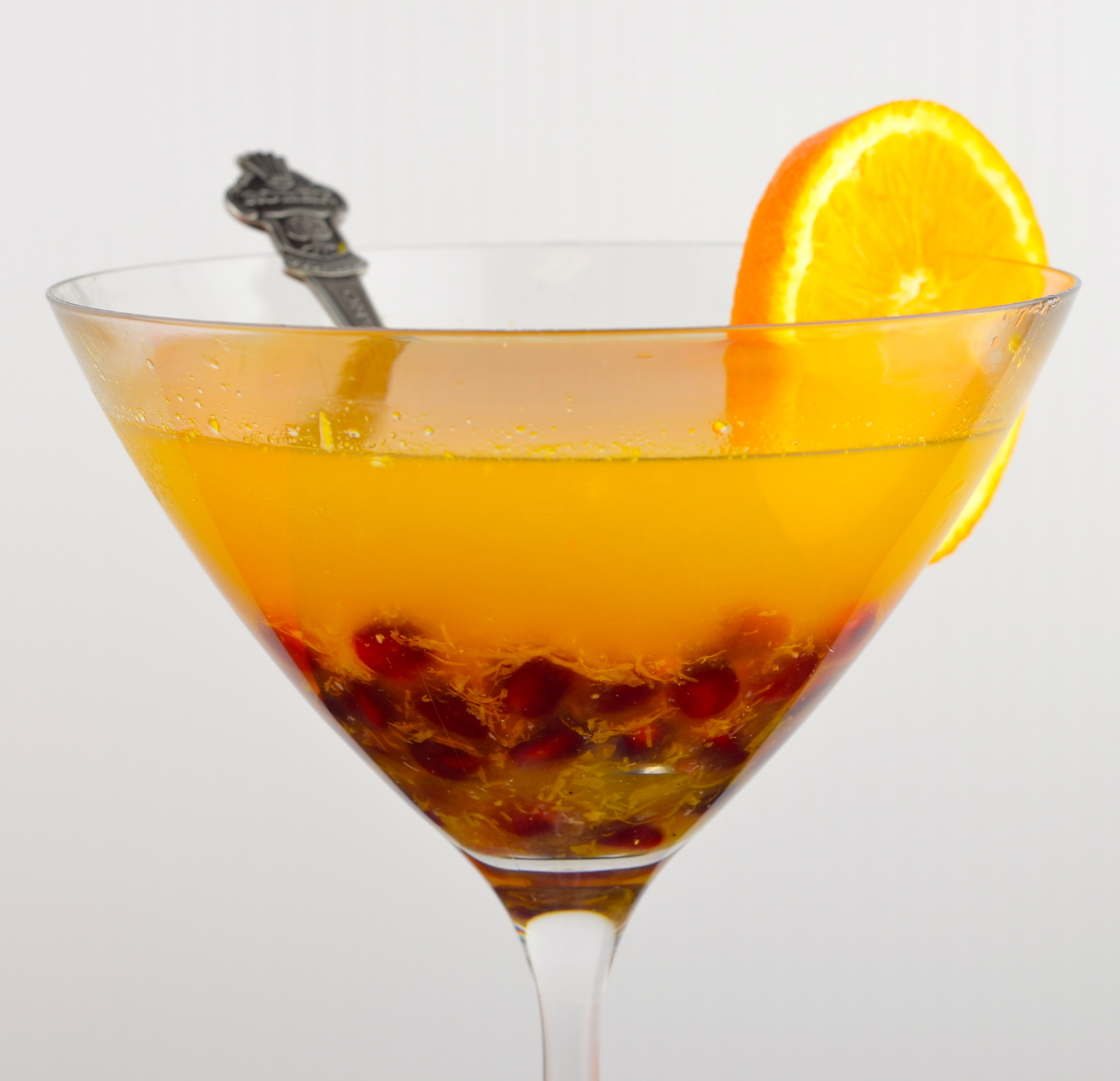 citrus arak cocktail with pomegranates
